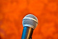 Black microphone on an orange background Stock Image