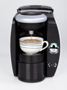A black modern espresso coffee machine is making a coffee Royalty Free Stock Photo