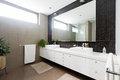 Black mosaic tiled splashback and double basin bathroom Royalty Free Stock Photo
