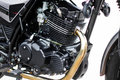 Black motorcycle engine, detail of motorcycle engine on white background. Royalty Free Stock Photo