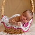 Black newborn baby sleeping in basket. Royalty Free Stock Photo