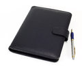Black note book and pen on white background Royalty Free Stock Photography