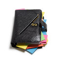 Black notebook with colorful note papers and pen on white background clipping path included Stock Photos