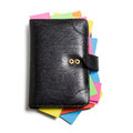 Black notebook with colorful note papers on white background clipping path included Royalty Free Stock Photography