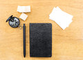 Black notebook, pen, compass and business card on wood table, Mock Royalty Free Stock Photo