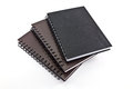 Black notebooks isolated white ovelap Stock Photography