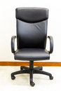 Black office chair executive with wall Royalty Free Stock Images