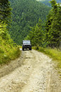 Black offroad vehicle in the mountains Royalty Free Stock Photography