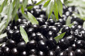 Black olives with leaves Royalty Free Stock Photo