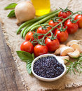 Black organic rice, olive oil, vegetables and herbs Royalty Free Stock Photo