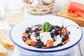 Black pasta spaghetti with cream sauce and smoked salmon Italian cuisine Royalty Free Stock Photo