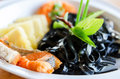 Black pasta spaghetti with smoked salmon Italian Royalty Free Stock Photo