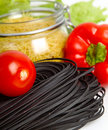 Black pasta with vegetables Stock Photos