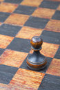Black pawn chessboard vintage wooden piece on Stock Photography