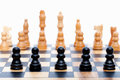 Black pawns lined up Royalty Free Stock Photo