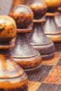 Black pawns row Royalty Free Stock Photo