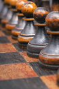 Black pawns in row Royalty Free Stock Photo