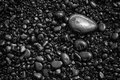 Black pebbles background pattern Royalty Free Stock Photo