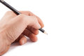 Black pen in a left hand on white background Stock Image