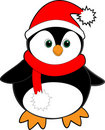 Black penguin with a red santa hat and scarf Royalty Free Stock Images
