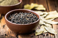 Black pepper in a bowl Stock Images
