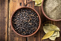 Black pepper in a bowl Stock Photo