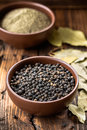Black pepper in a bowl Stock Image