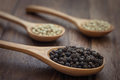 Black pepper and white pepper on wooden spoon Royalty Free Stock Photo