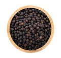 Black pepper in wooden bowl Royalty Free Stock Photo