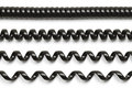 Black phone cord segments that range from closed up to stretched out Royalty Free Stock Photos