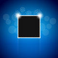 Black photoframe on a blue background Royalty Free Stock Images