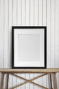 Black picture frame on wood table Royalty Free Stock Photo