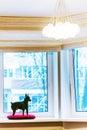 Black pincher dog near the window Stock Photos