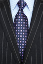 Black pinstripe suit and purple tie Royalty Free Stock Photo