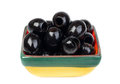 Black pitted olives in colored ceramic ware Stock Photo