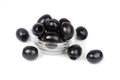 Black pitted olives in glass isolated on white macro Stock Photography