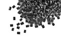 Black plastic granules on white background Royalty Free Stock Photo