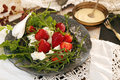 Black plate with strawberry on old white lace tablecloth. Royalty Free Stock Photo