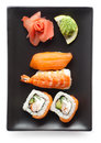 Black plate with sushi Stock Image