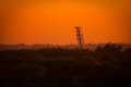 Black point wildlife drive landscape with a tower in distant at sunset merritt island national refuge titusville florida Stock Photography