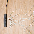 Black power strip white cords Royalty Free Stock Photo
