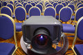 Black projector in center of rows of chairs Stock Photography