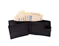 Black purse stuffed paper money isolated white background Royalty Free Stock Photography