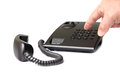 Black push-button telephone and the hand that dials the number Royalty Free Stock Photo