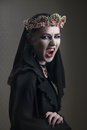 Black queen in a crown of rubies, scream Royalty Free Stock Photo