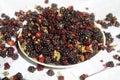 Black raspberry colorful fresh sweet prick raspberries lay in bowl Stock Photo