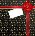 Black-red background with bow and empty card Royalty Free Stock Photography