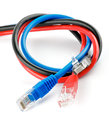 Black, red and blue UTP cords with RJ-45 Connector Royalty Free Stock Photography