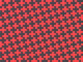 Black and red cross jigsaw puzzle background seamless pattern. 3 Royalty Free Stock Photo