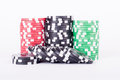 Black, red and green casino chips isolated on white Royalty Free Stock Photo